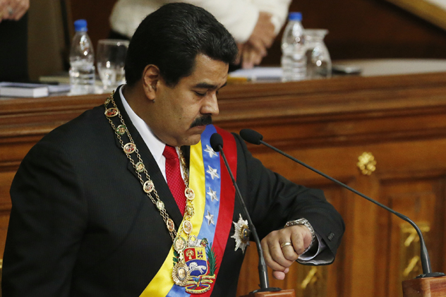 Maduro looks at his watch as he delivers his annual State of the Nation address at the National Assembly in Caracas