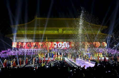 Dancers perform to celebrate the new year during a countdown event at Tai Miao in Beijing