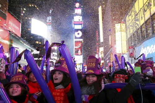Revelers gather as confetti falls during New Year celebrations in Times Square in the Manhattan borough of New York.