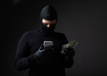robber-in-a-black-mask-and-suit_219728-1720